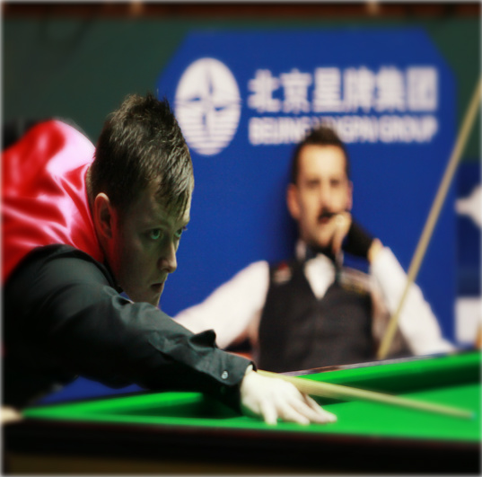 Mark Allen with Adolf Hitler looking on.