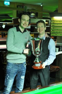 Last year's champion Martin O'Donnell presents the trophy to this year's winner David Gray.